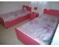 2 lits rose avec table de nuit